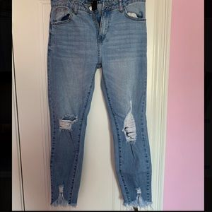 High-waist cropped ripped jeans